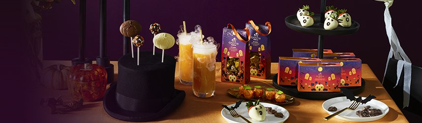 Chocolate pops, ghost chocolate strawberries, chocolate pretzels and truffles in halloween package