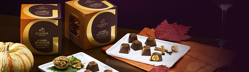 G Cube gift boxes with g cube truffles on plate