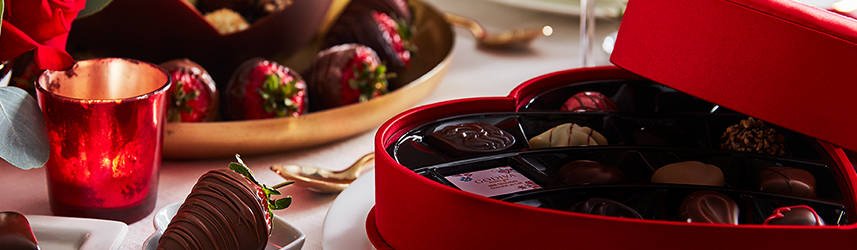 Heart Shaped Chocolate Boxes next to plate of strawberries