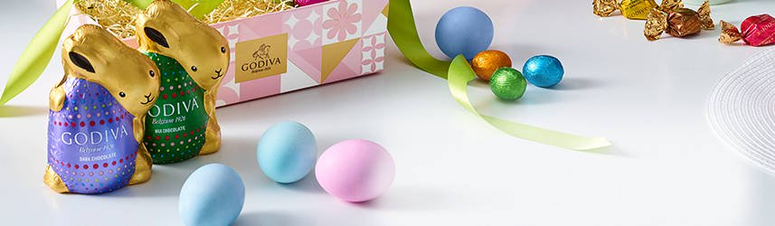 Chocolate foil bunnies next ot spring gift box and Easter eggs
