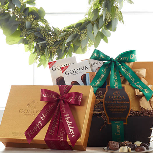 Stacked chocolate truffles alongside a plate of chocolate pieces and favor gift box